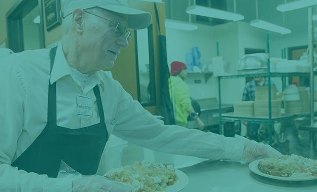 Happy volunteer serving plates of food