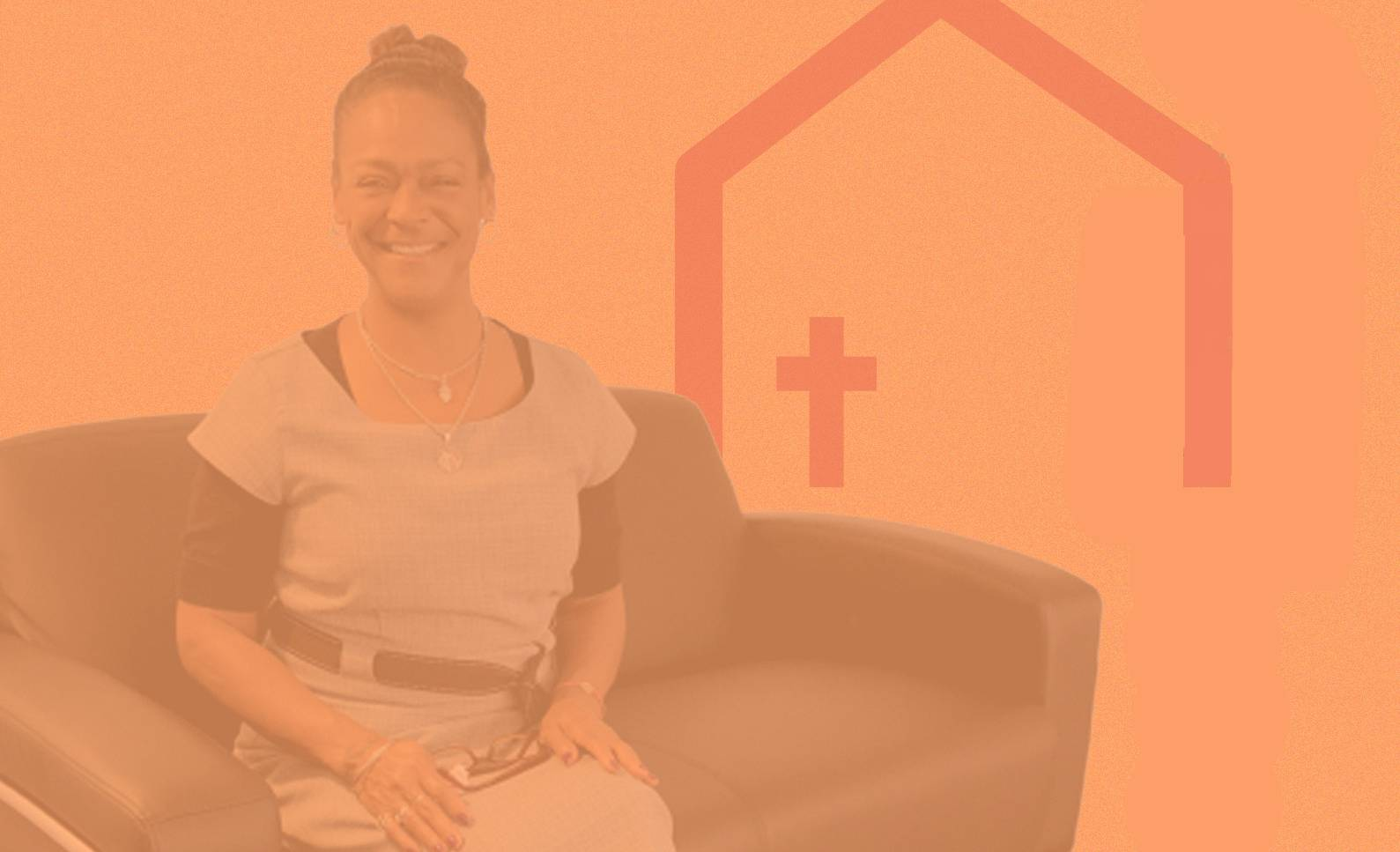 Woman sitting on chair smiling with Shelter KC icon behind her red tinted