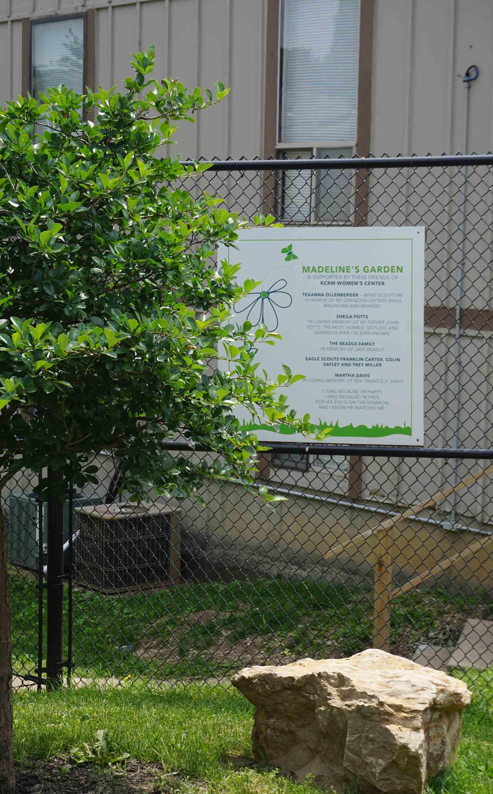 Madeline's Garden sign on gate