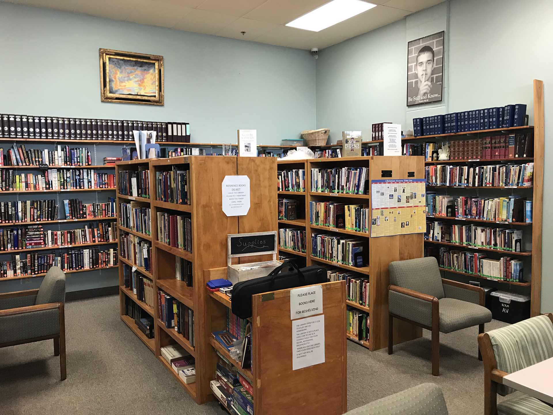 Library at Shelter KC with shelves of books