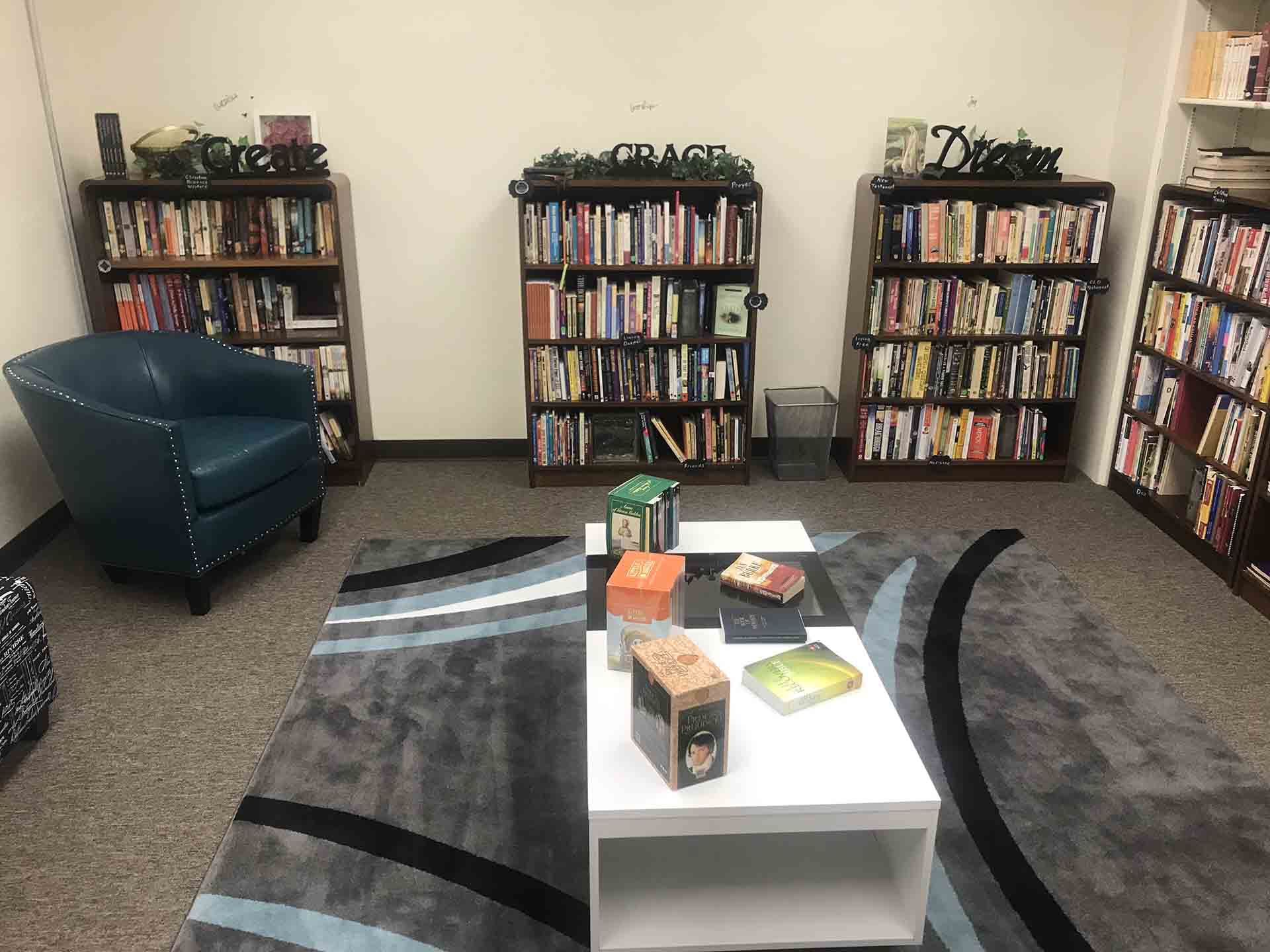 Library at Shelter KC with shelves full of books