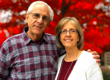 Joe and wife smile for headshot