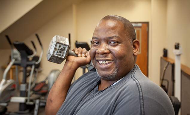Smiling man works out in gym