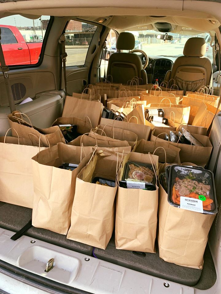 packages of food in the back of a car